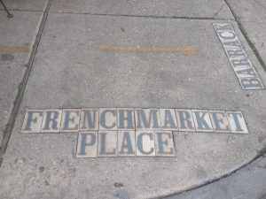 tiny travel chick new orleans french market place sign