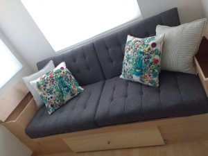 tiny travel chick travel experience tiny house couch storage