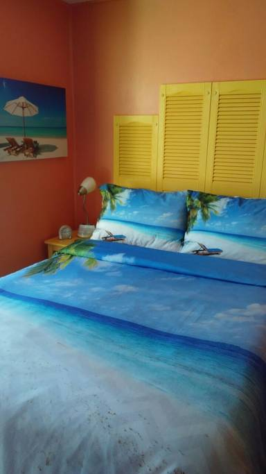 tiny travel chick incredible travel colorful corner airbnb queen bed