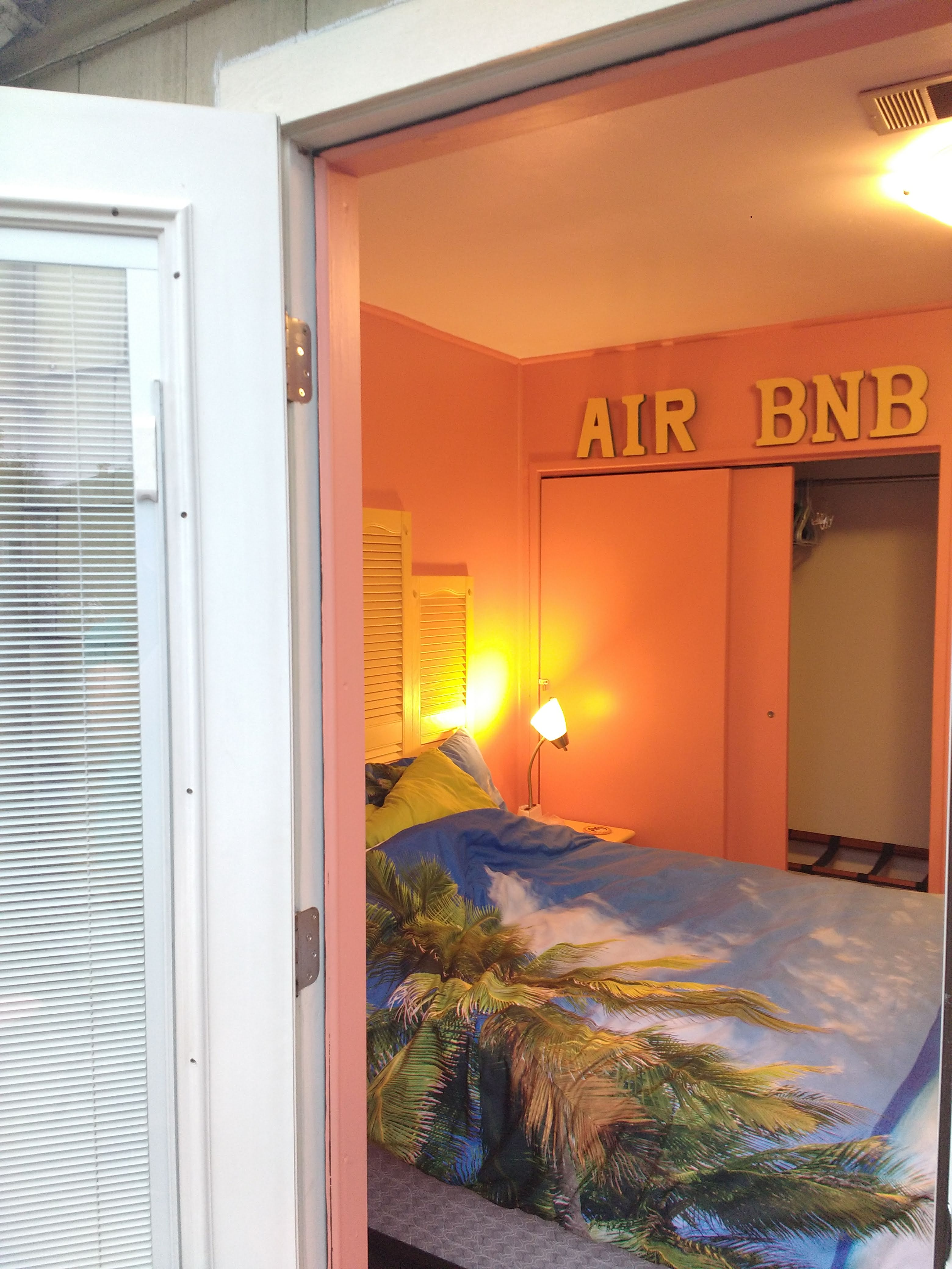 tiny travel chick incredible travel colorful corner airbnb sign