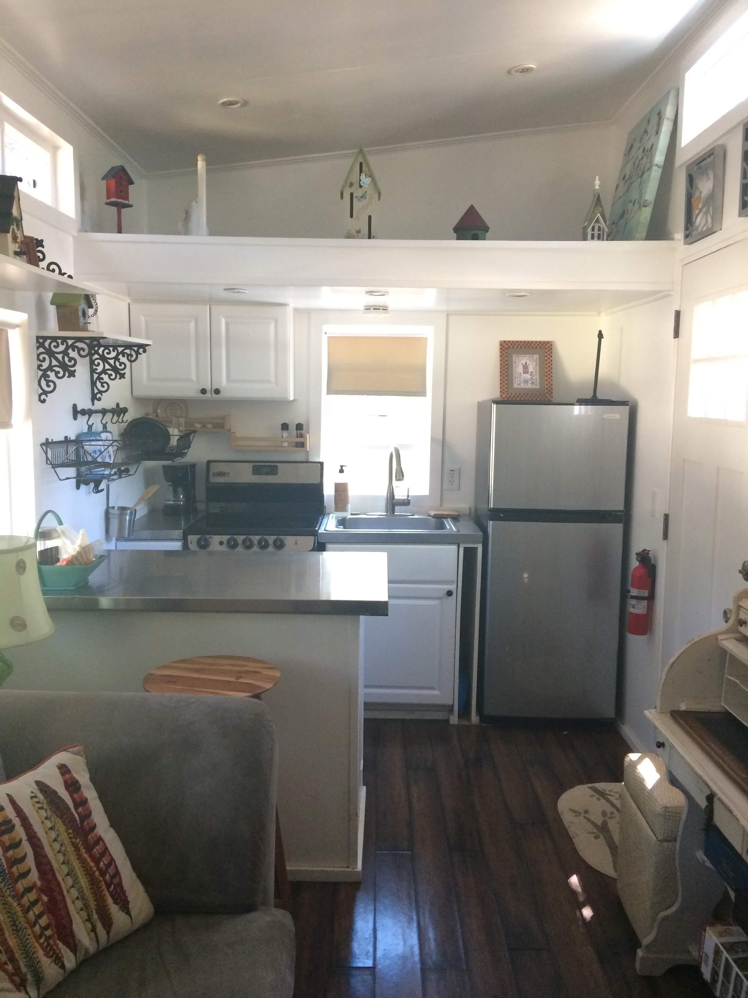 tiny travel chick tiny house block blue sky kitchen